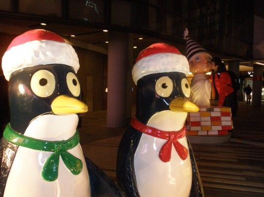 Two penguins dressed as Santa walk into a bar...
