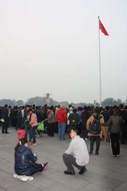 Come early if you want to watch the lowering of the Chinese flag on Tiananmen Square